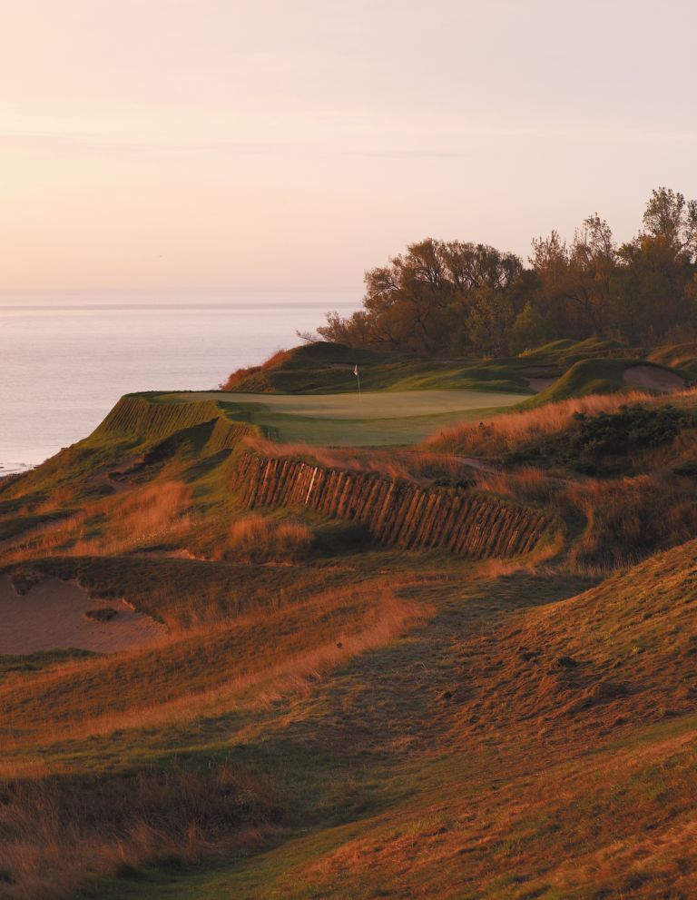 The green of hole 17 on the Straits Course with Lake Michigan on the left.