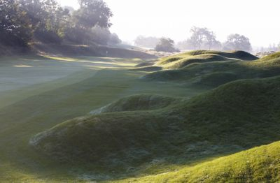The fariway near the green of the second hole on the River Course hazy sunshine.