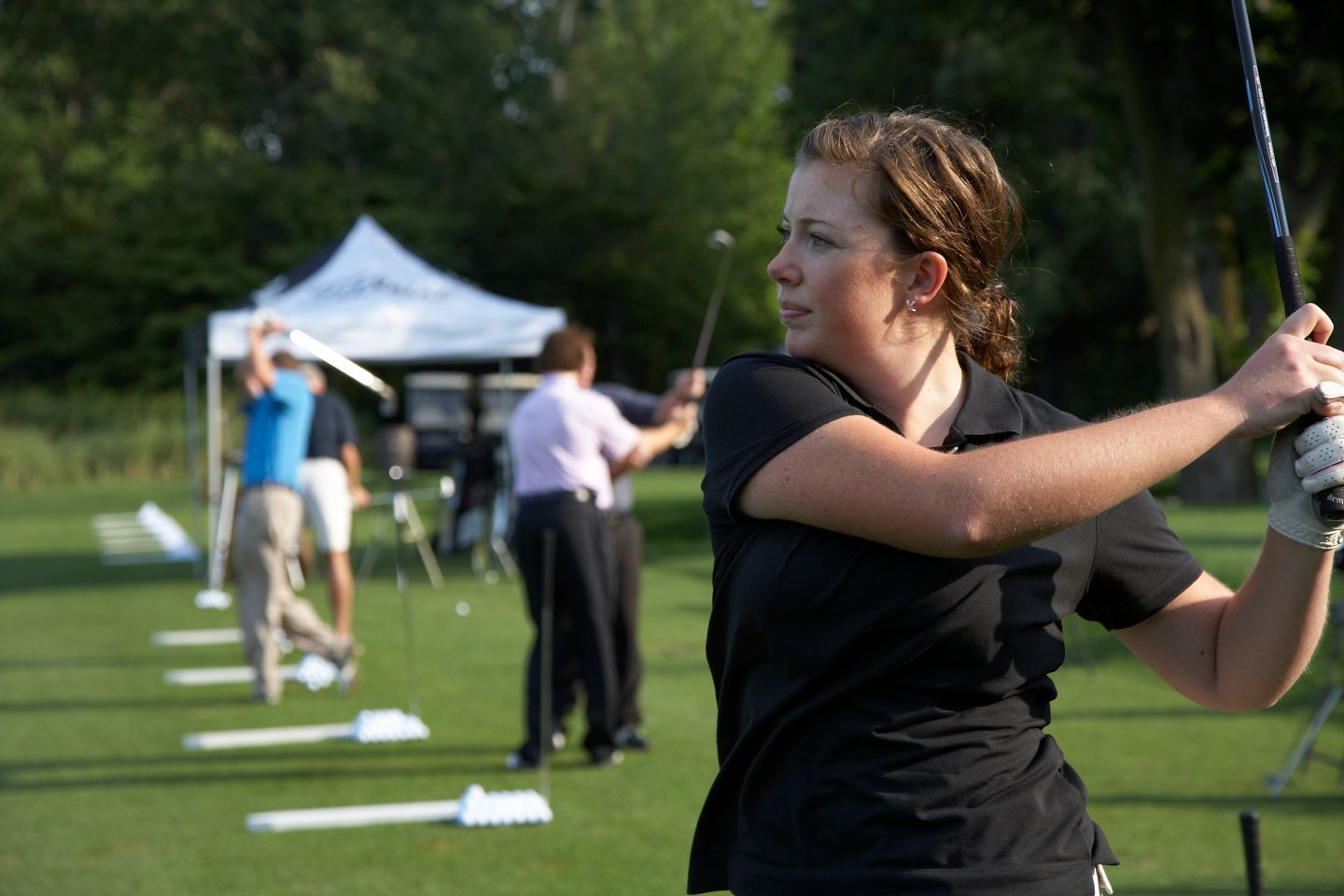Female golfer at Blackwolf Run practice facility