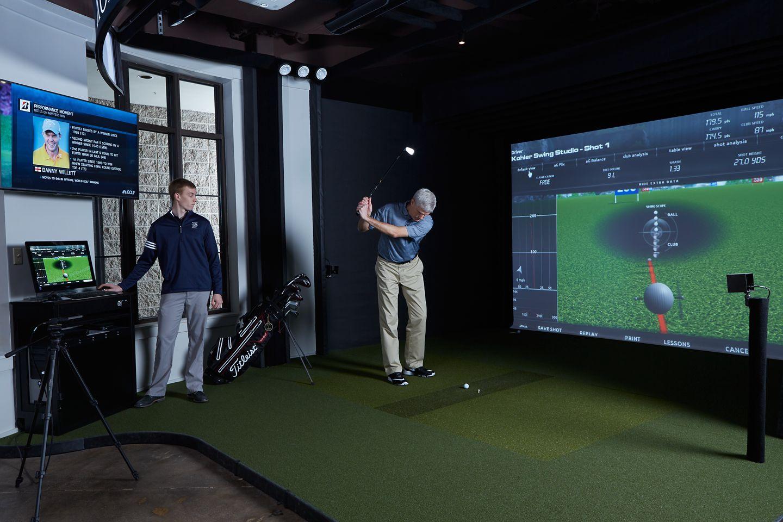 A golf lesson at Kohler Swing Studio