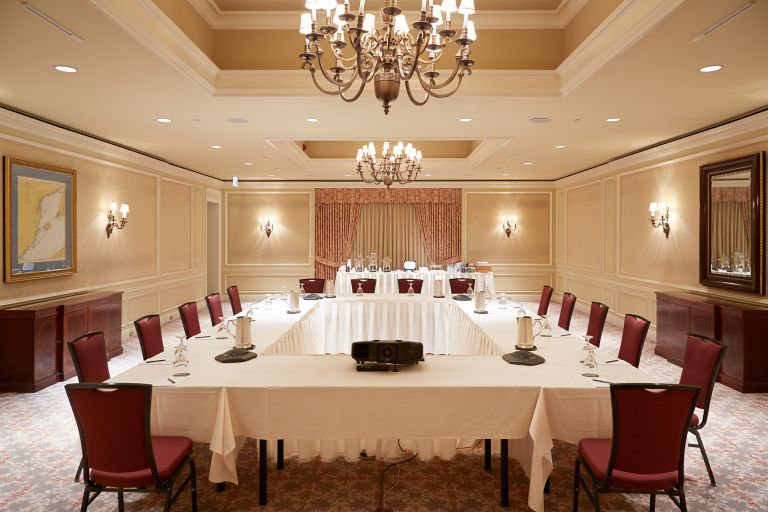 A conference room at The American Club set up for a meeting.