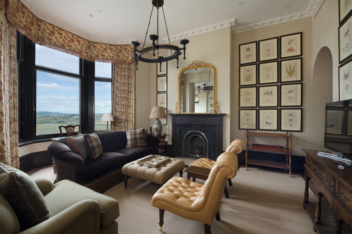 An apartment living area in Hamilton Grand with views out over the Old Course Golf Course, St Andrews