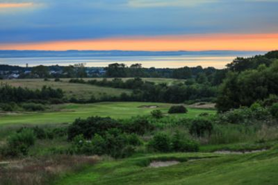 No. 14 Well. Looking from the 14th tee at The Duke's towards the green at dusk.