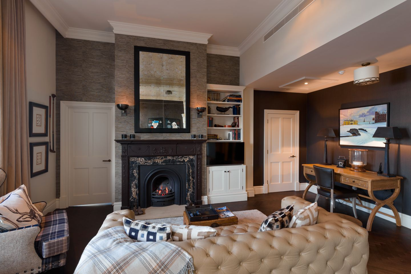 An apartment living area in Hamilton Grand with fireplace and leather couch, St Andrews