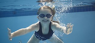 kid swimming underwater