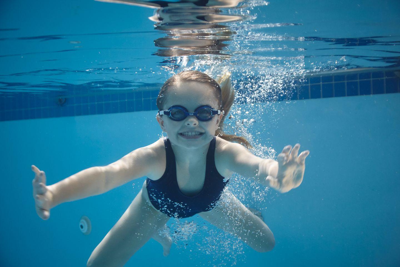 child swimming under water