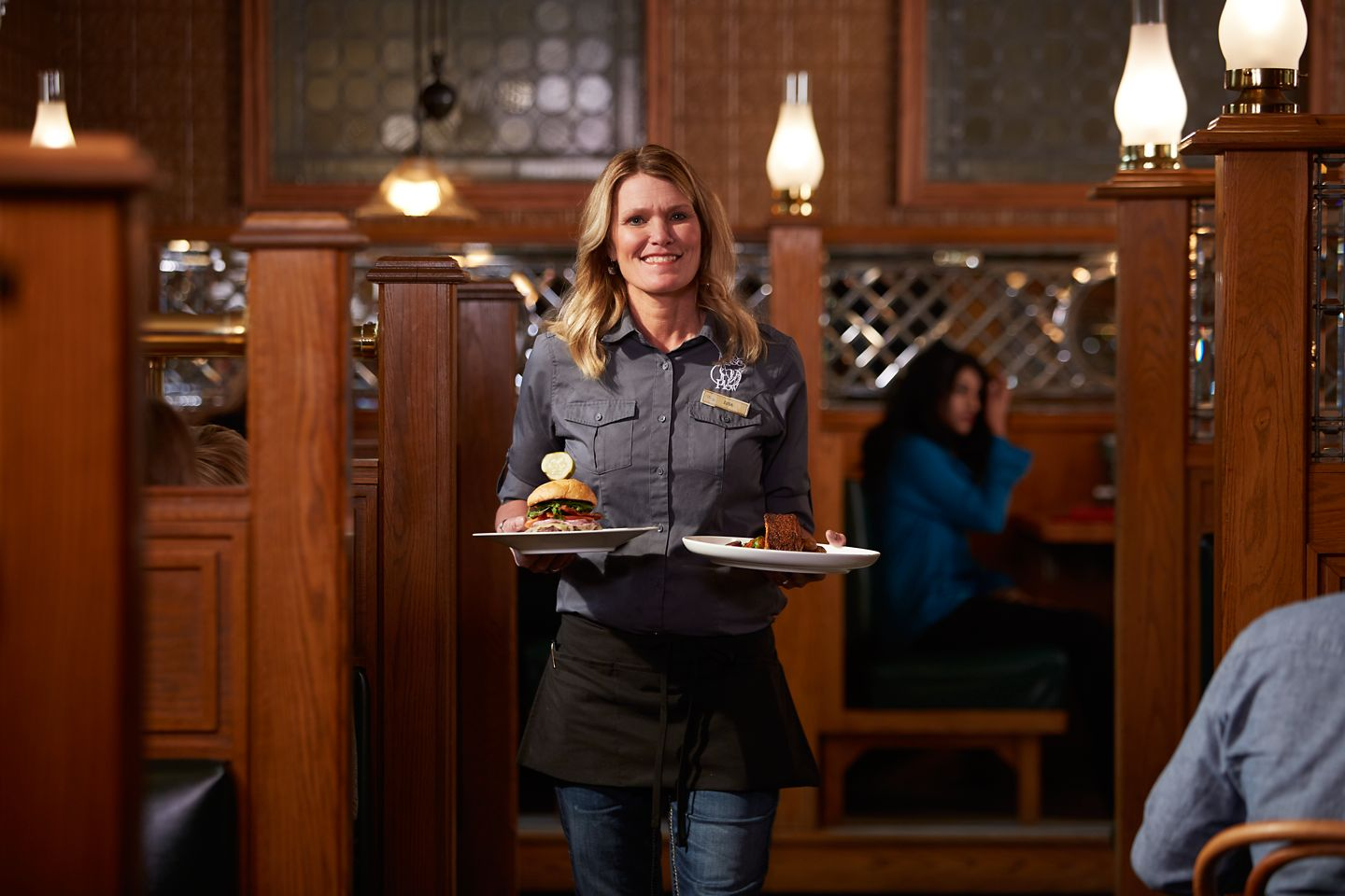The Horse & Plow waitress delivering food