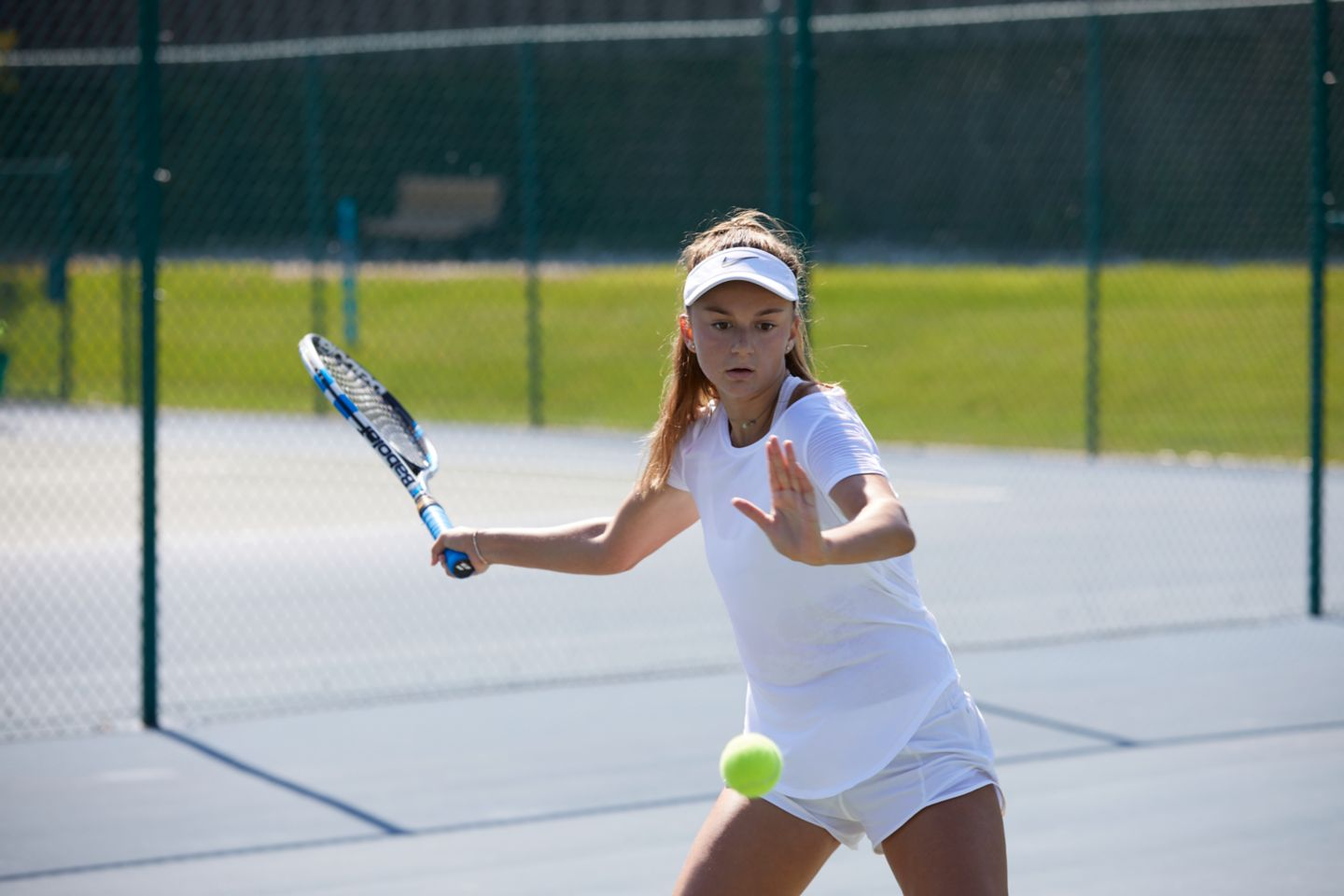 Youth tennis player playing on outdoor courts