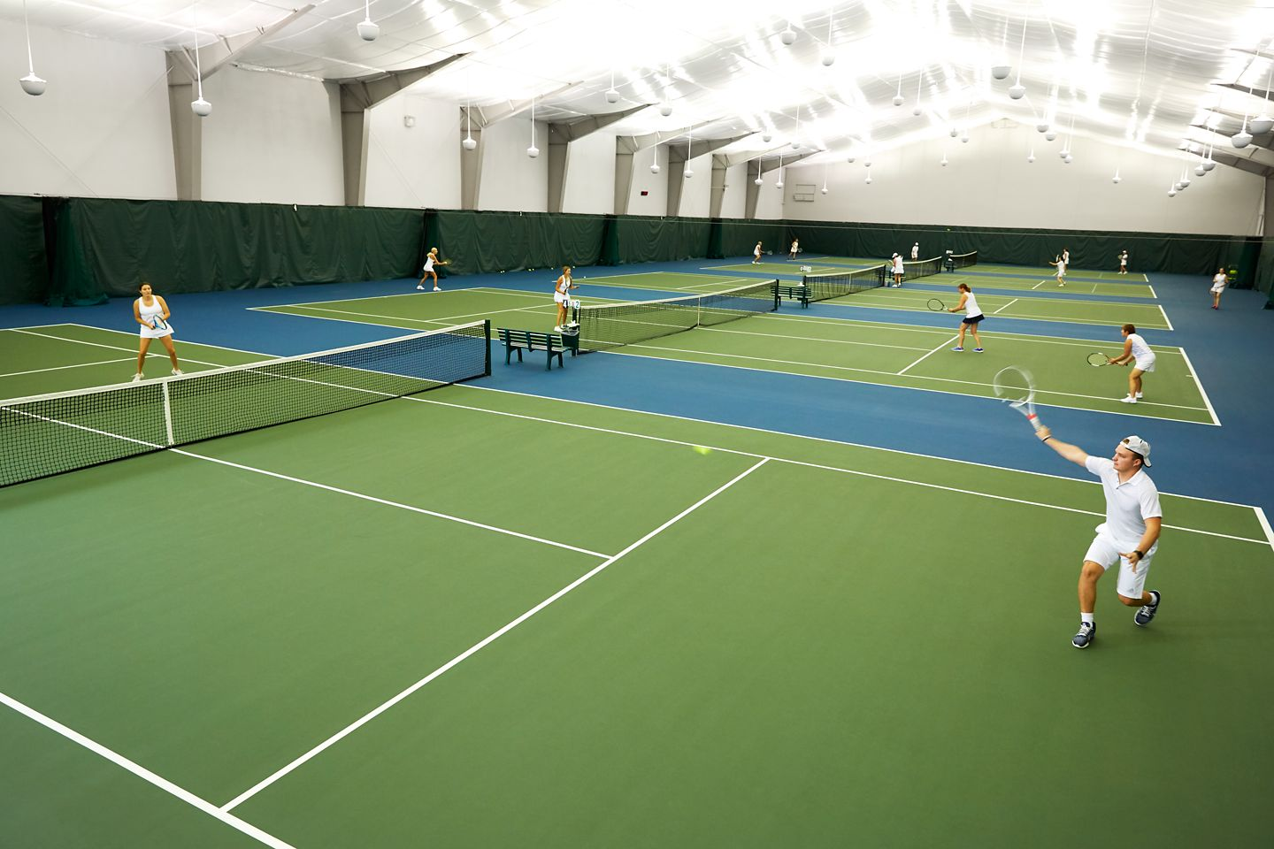 Tennis players playing on indoor courts