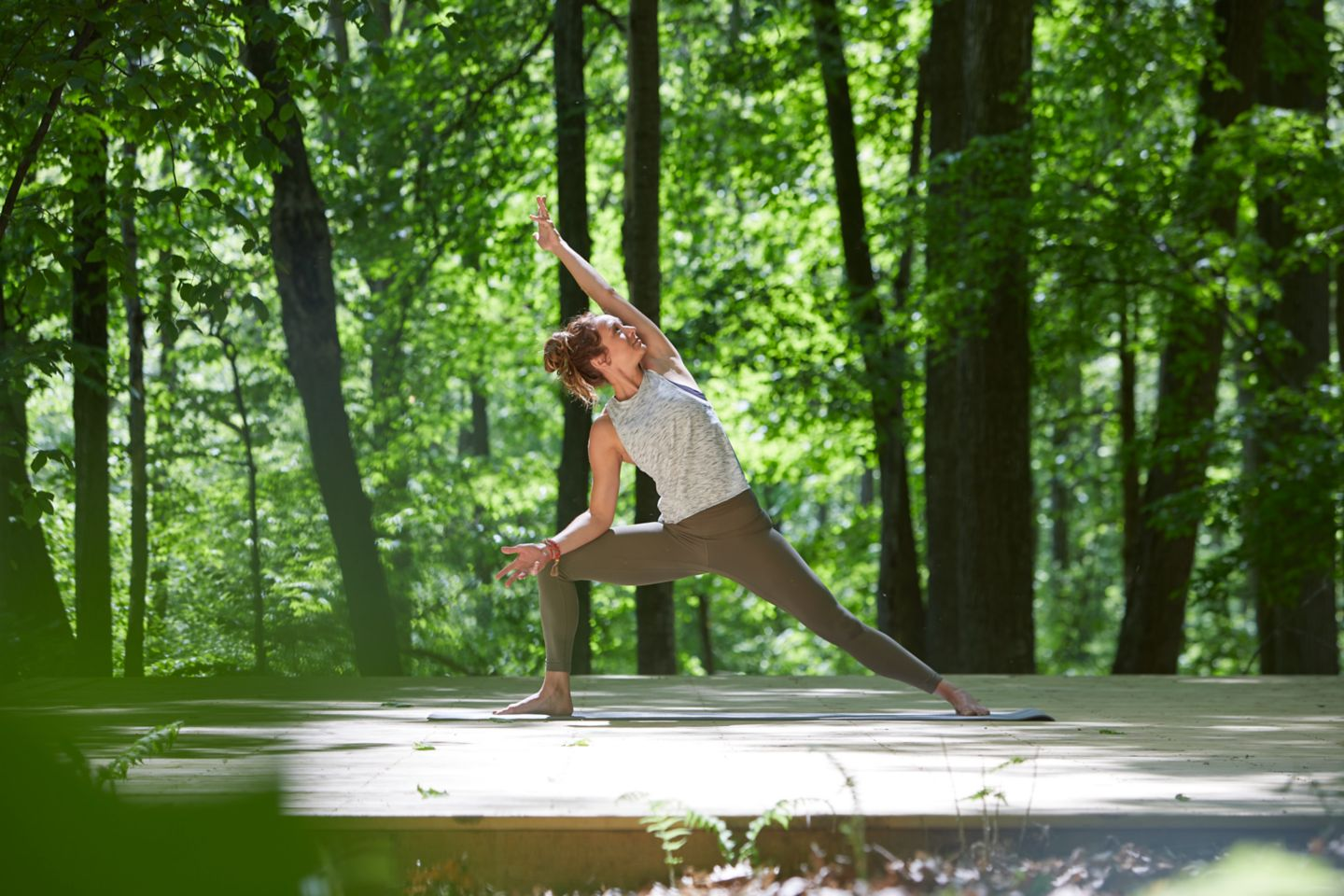 outdoor yoga on a wooden platform in the woods