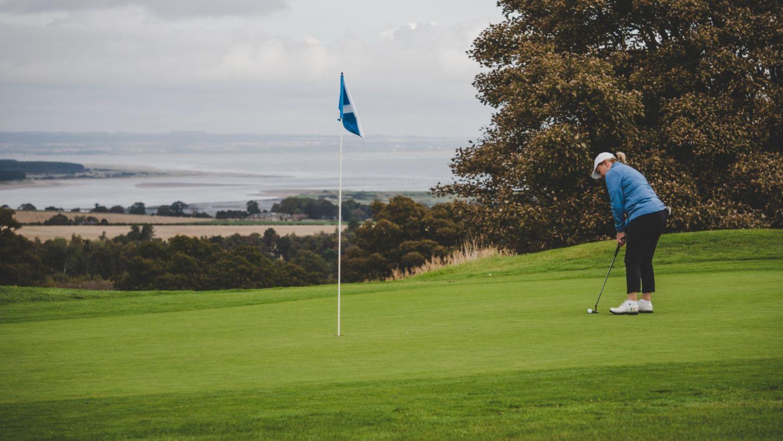 Female golfer on the 6th green of The Duke's