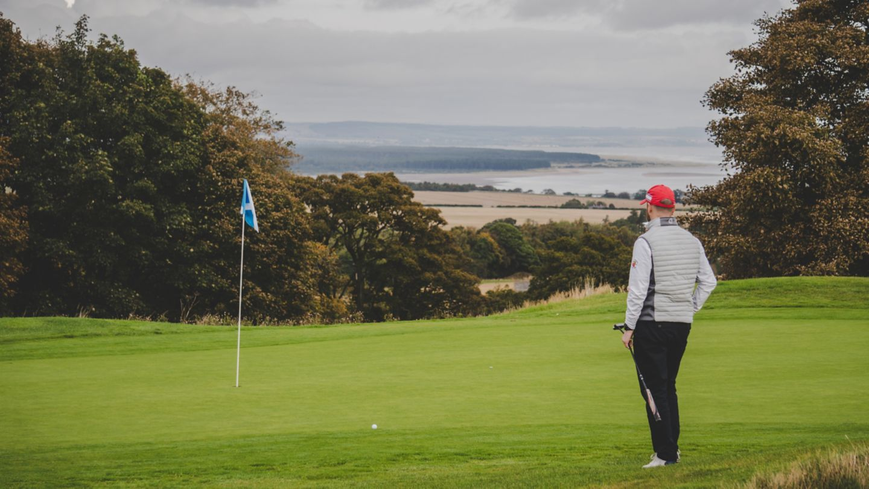 Male golfer on 6th green of The Duke's