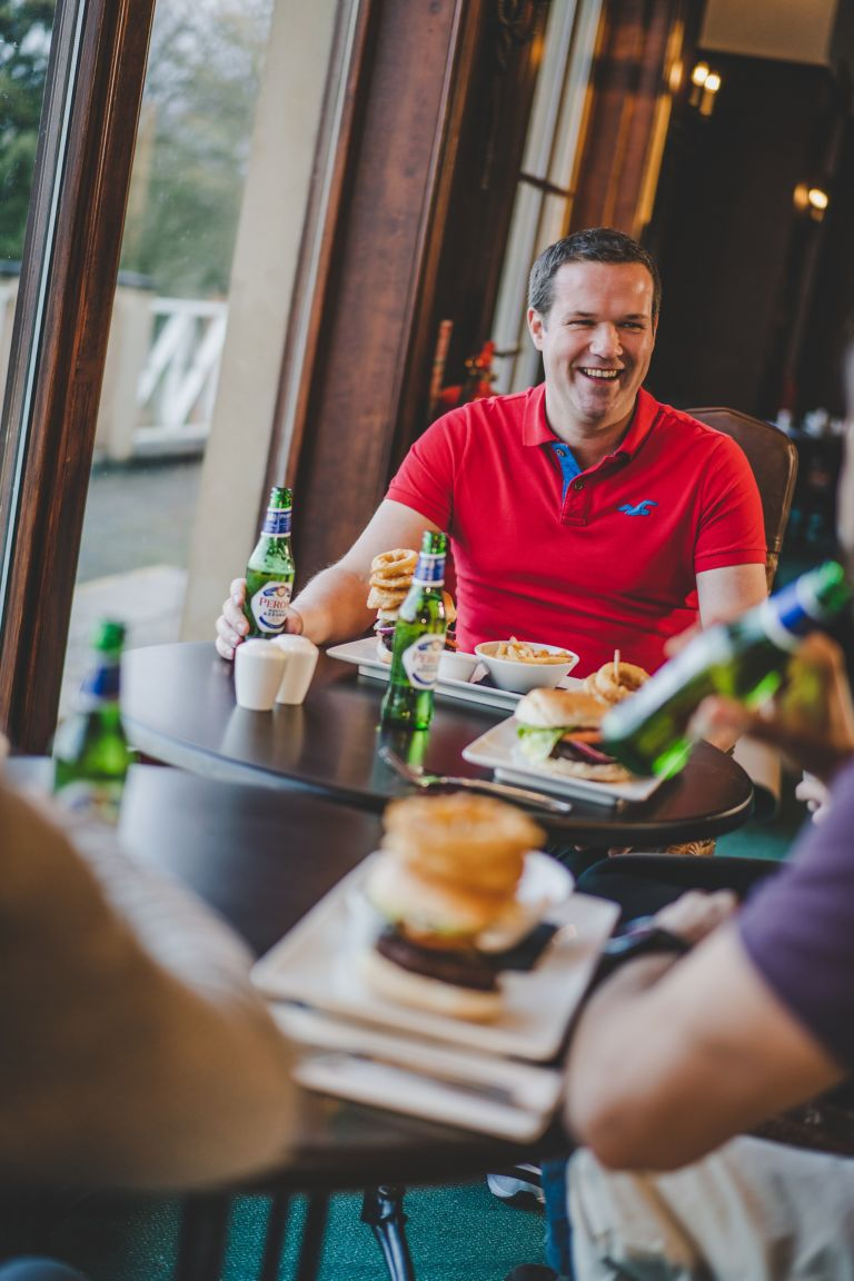 Group of golfers enjoying a meal at The Duke's Clubhouse
