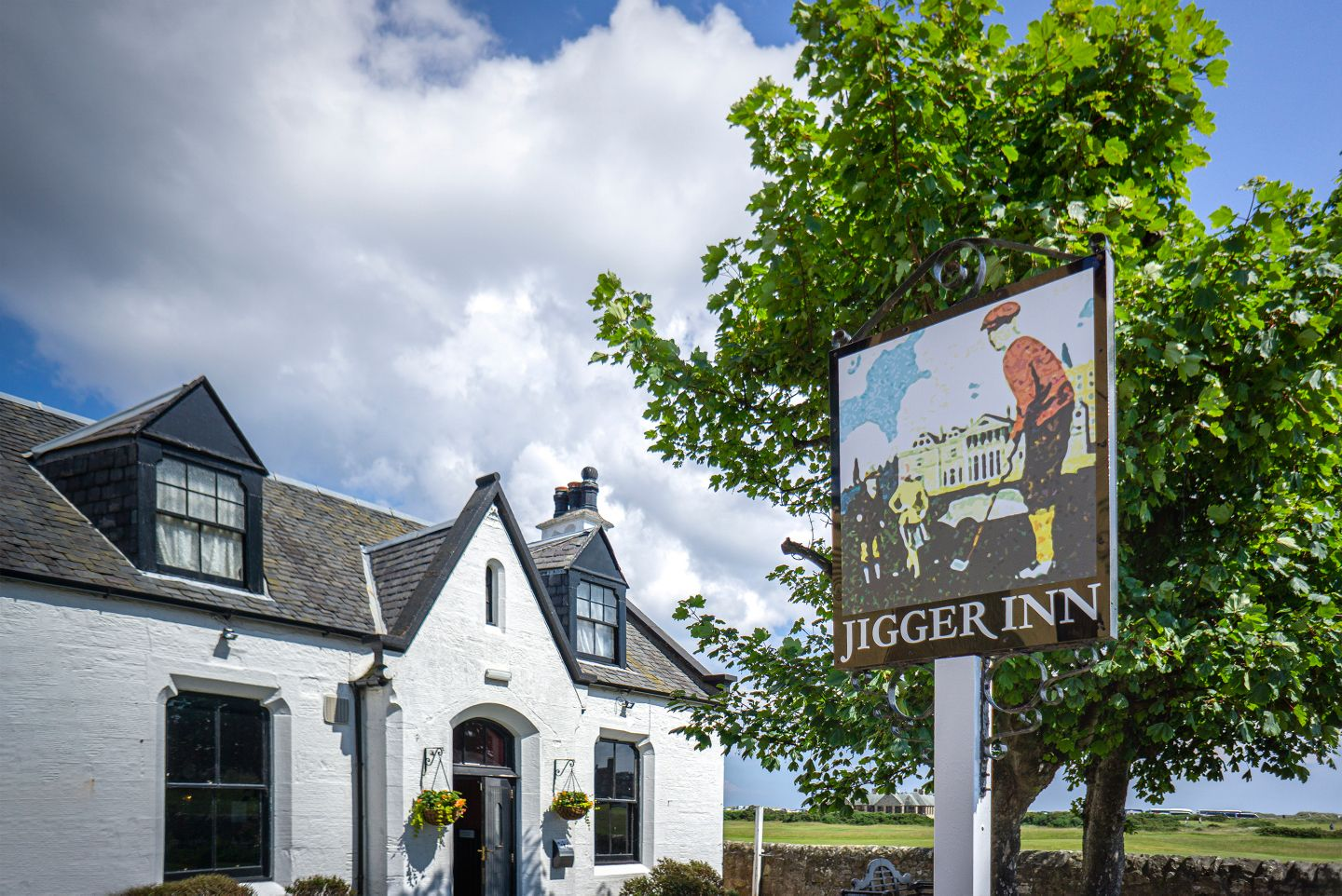 The Jigger Inn exterior and sign
