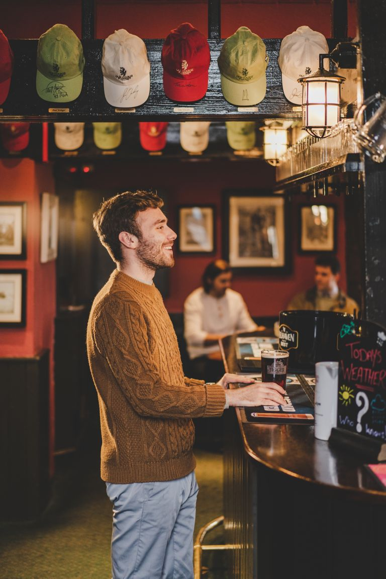Man standing at the Jigger Inn bar
