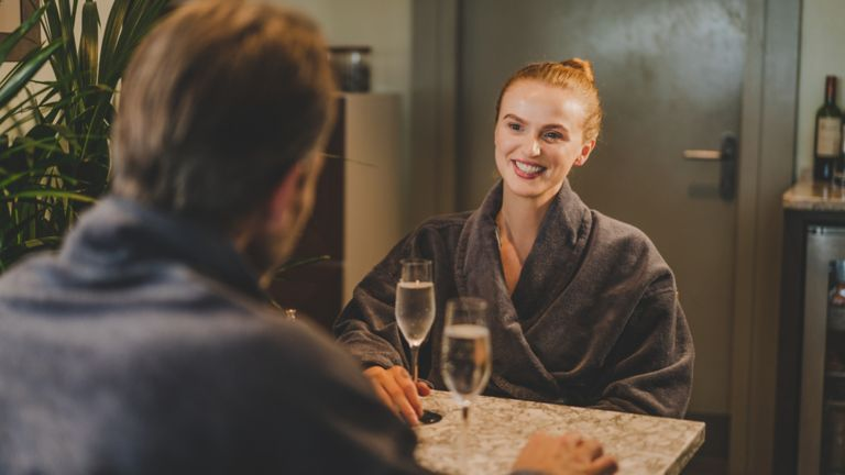 Woman and man in Kohler Waters Spa Cafe drinking champagne