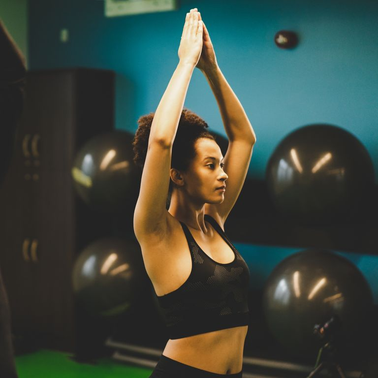Woman doing yoga in Kohler Waters Fitness Centre