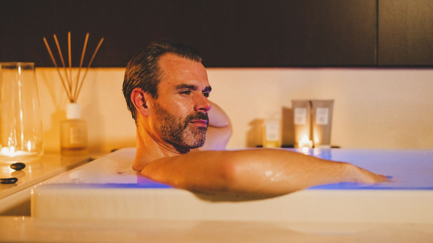 Man relaxing in SOK bath at Kohler Waters Spa, St Andrews