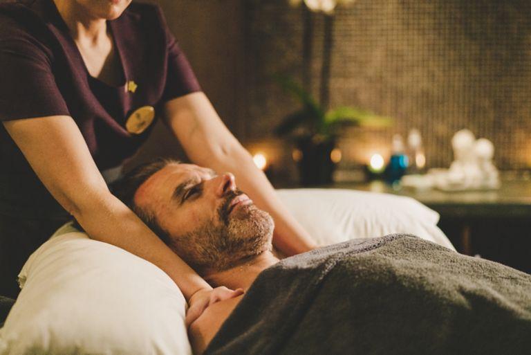 Man enjoying a shoulder and neck massage in Kohler Waters Spa, St Andrews