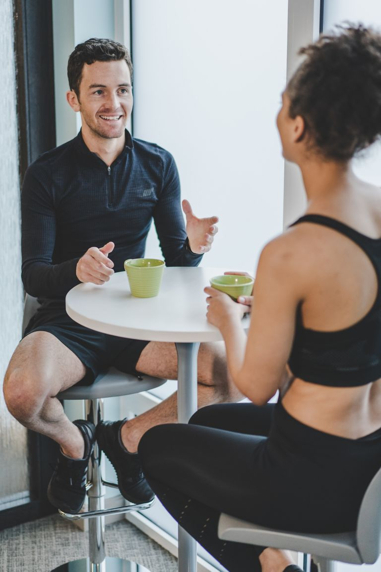 Man and woman having coffee in the Kohler Waters Fitness Centre