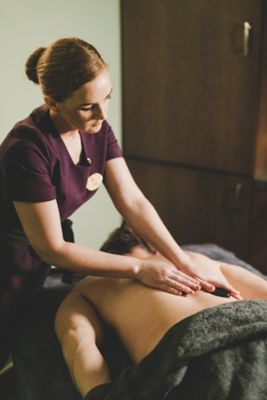 Kohler Waters Spa therapist and hot stone massage