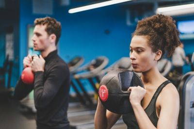 Male amd female working out in the Kohler Waters Spa Fitness Centre.