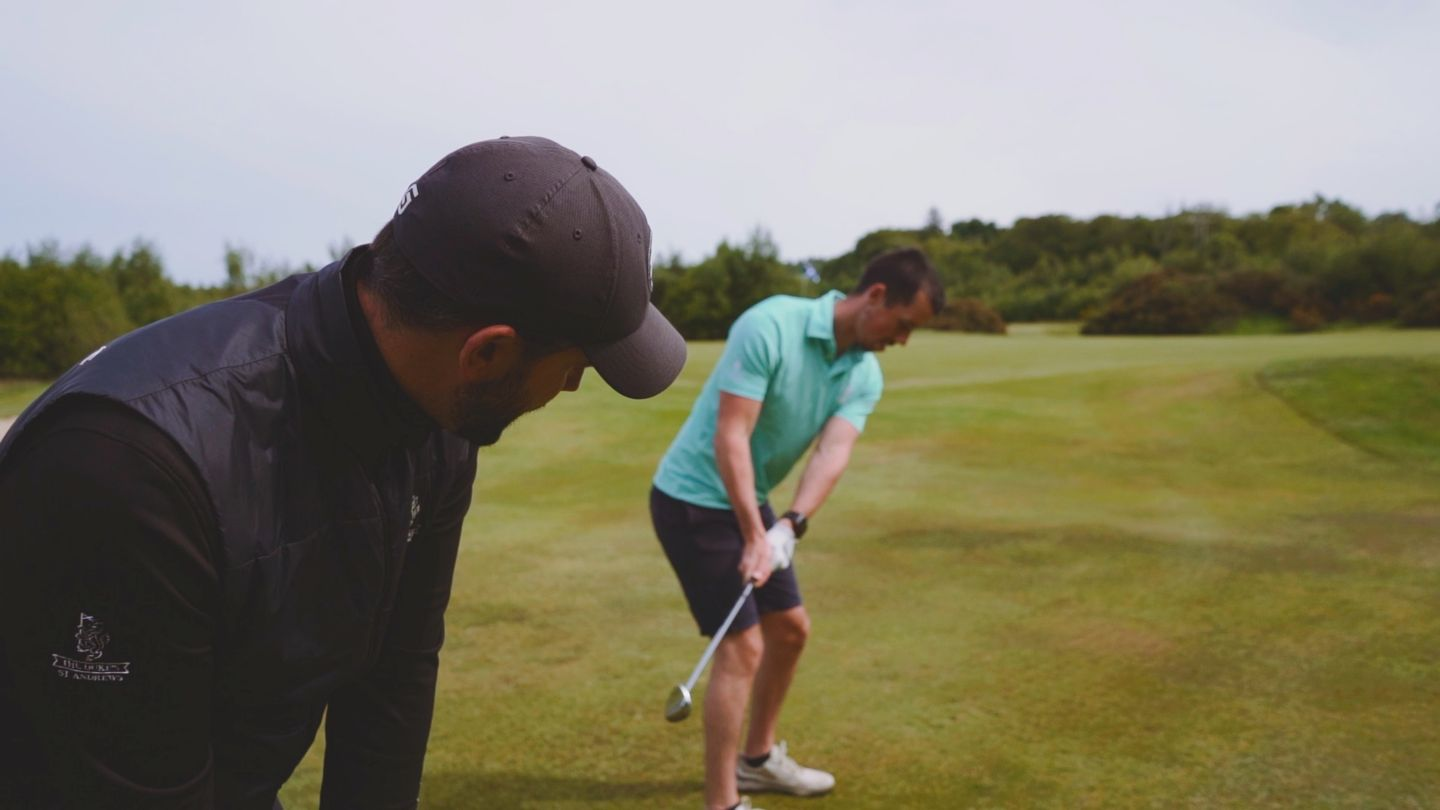 The Duke's PGA Professional and student practicing golf swing