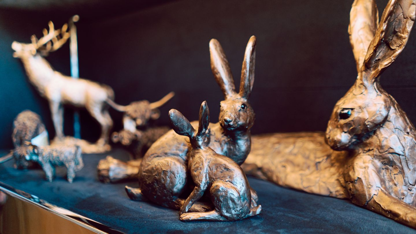 Hare statues in The Lone Piper