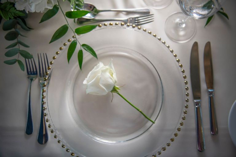White rose on a charger plate. Weddings at the Old Course Hotel, Golf Resort & Spa