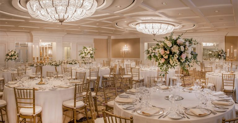 Wedding reception set up with flower arrangement and table set ups in the grand Ballroom venue space at the Old Course Hotel, Golf Resort & Spa.