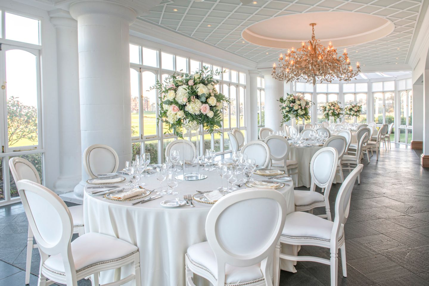 Wedding dinner in the Conservatory. View our wedding ceremony and reception spaces at the Old Course Hotel, Golf Resort & Spa