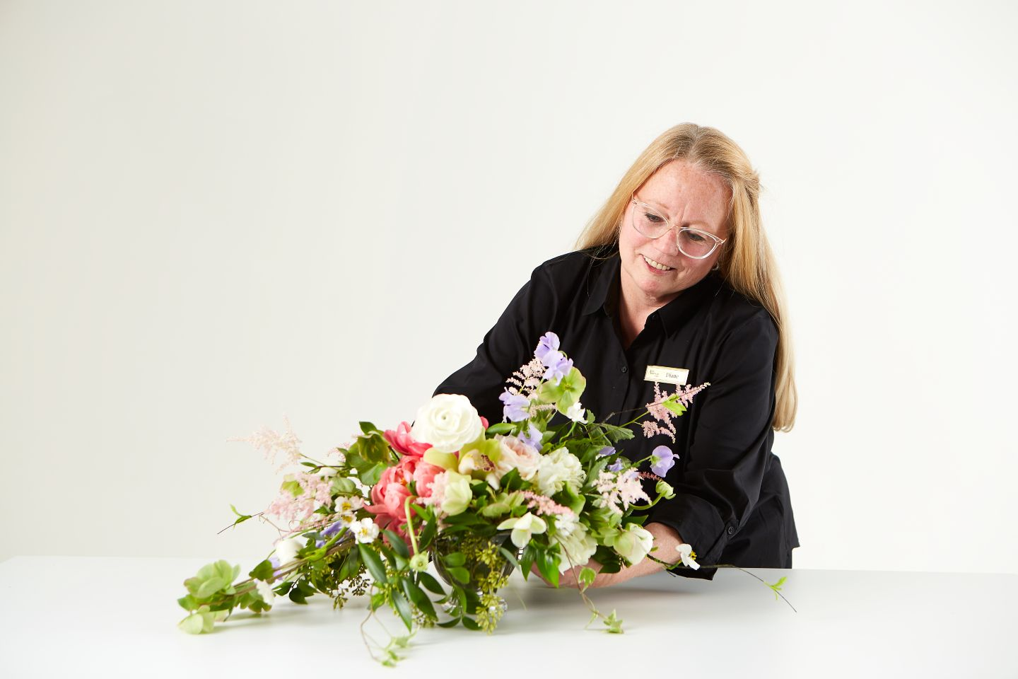 flowers being put into a display