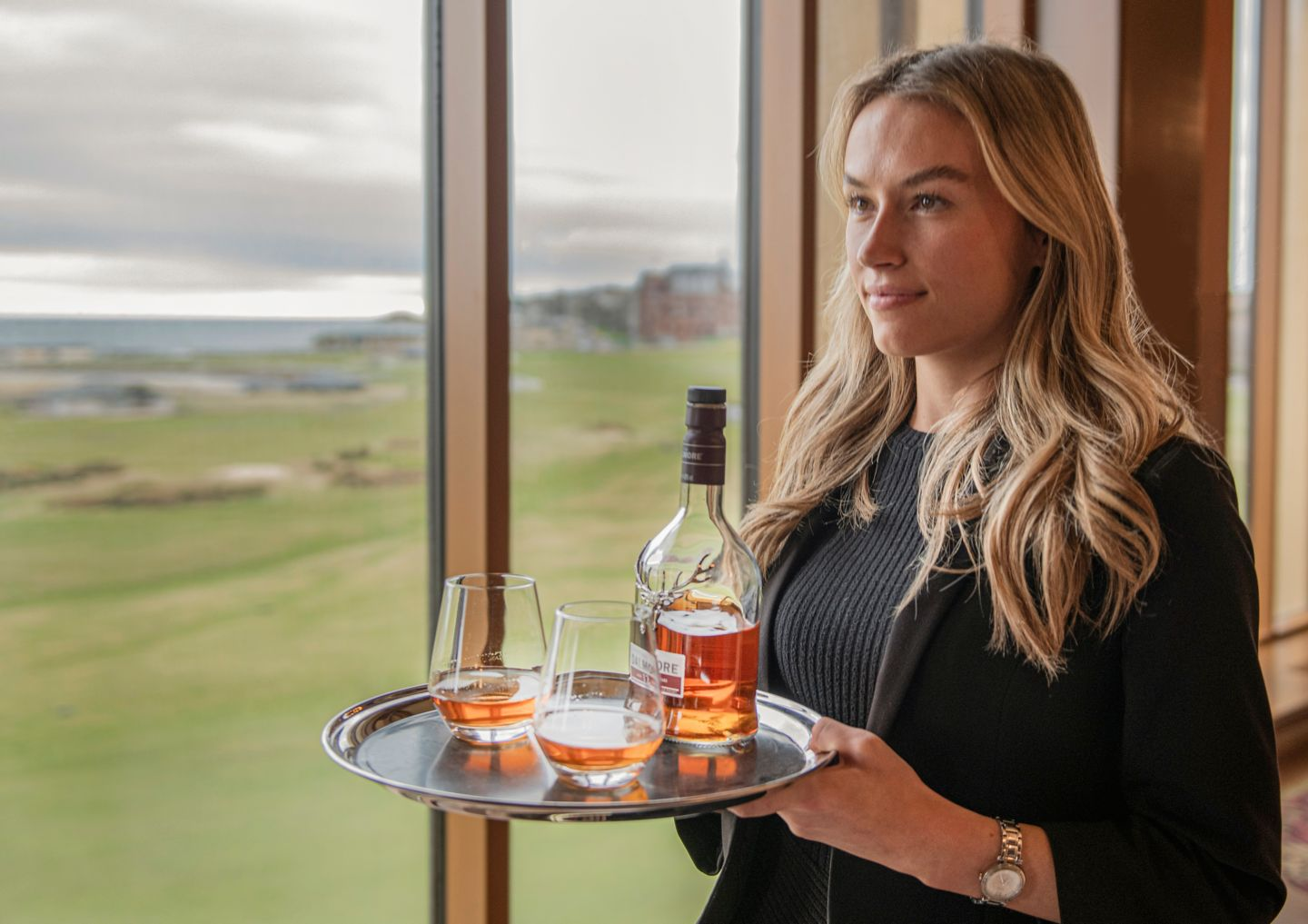 Delivering the whisky in the Road Hole Bar, Old Course Hotel, Golf Resort & Spa in St Andrews
