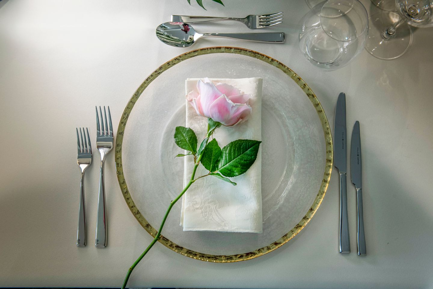 Pink rose on a dinner plate