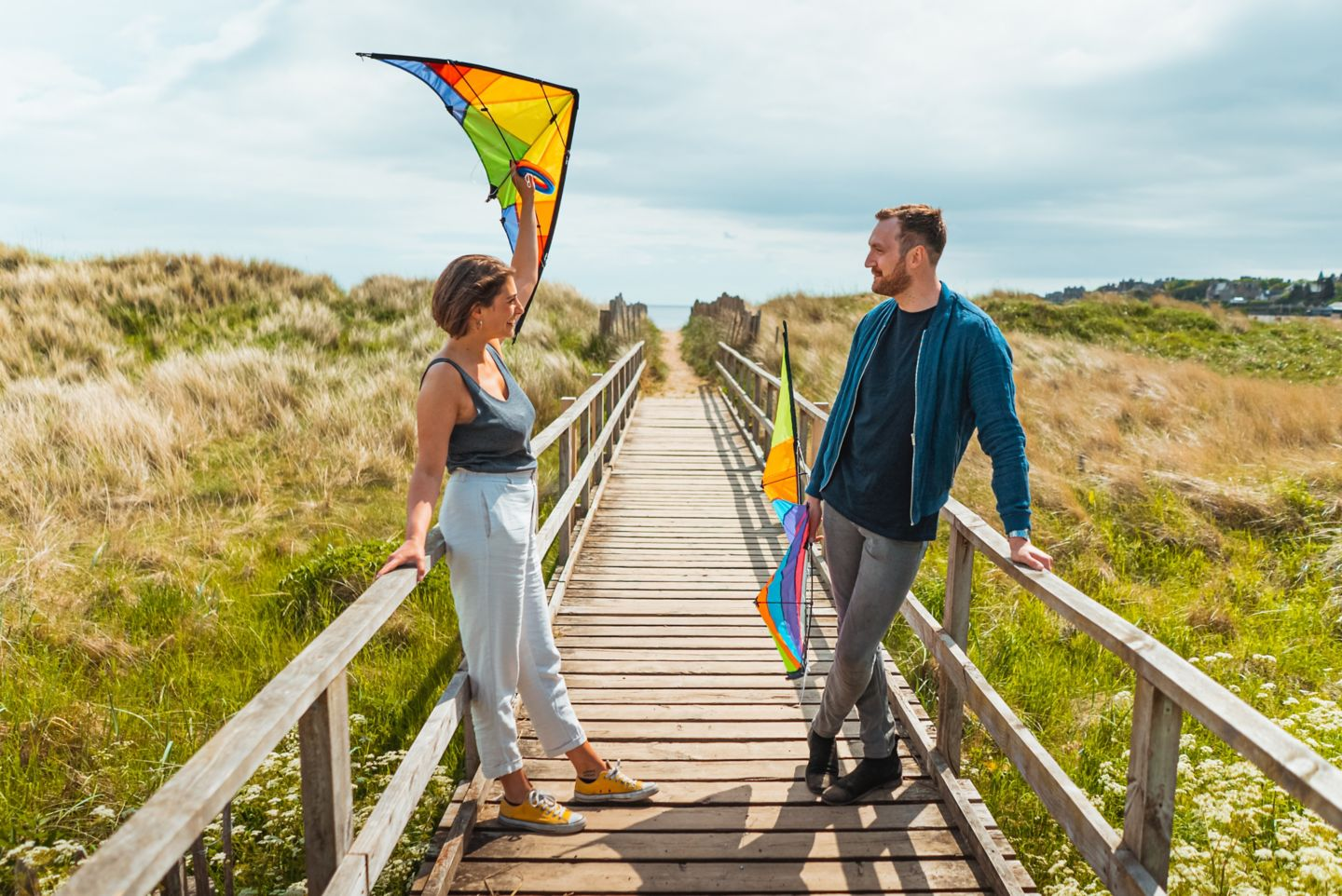 Standing on the path to the West Sands Beach with kites in St Andrews