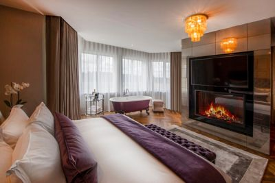 The Penthouse suite at the Old Course Hotel, St Andrews, with a fireplace and freestanding bath