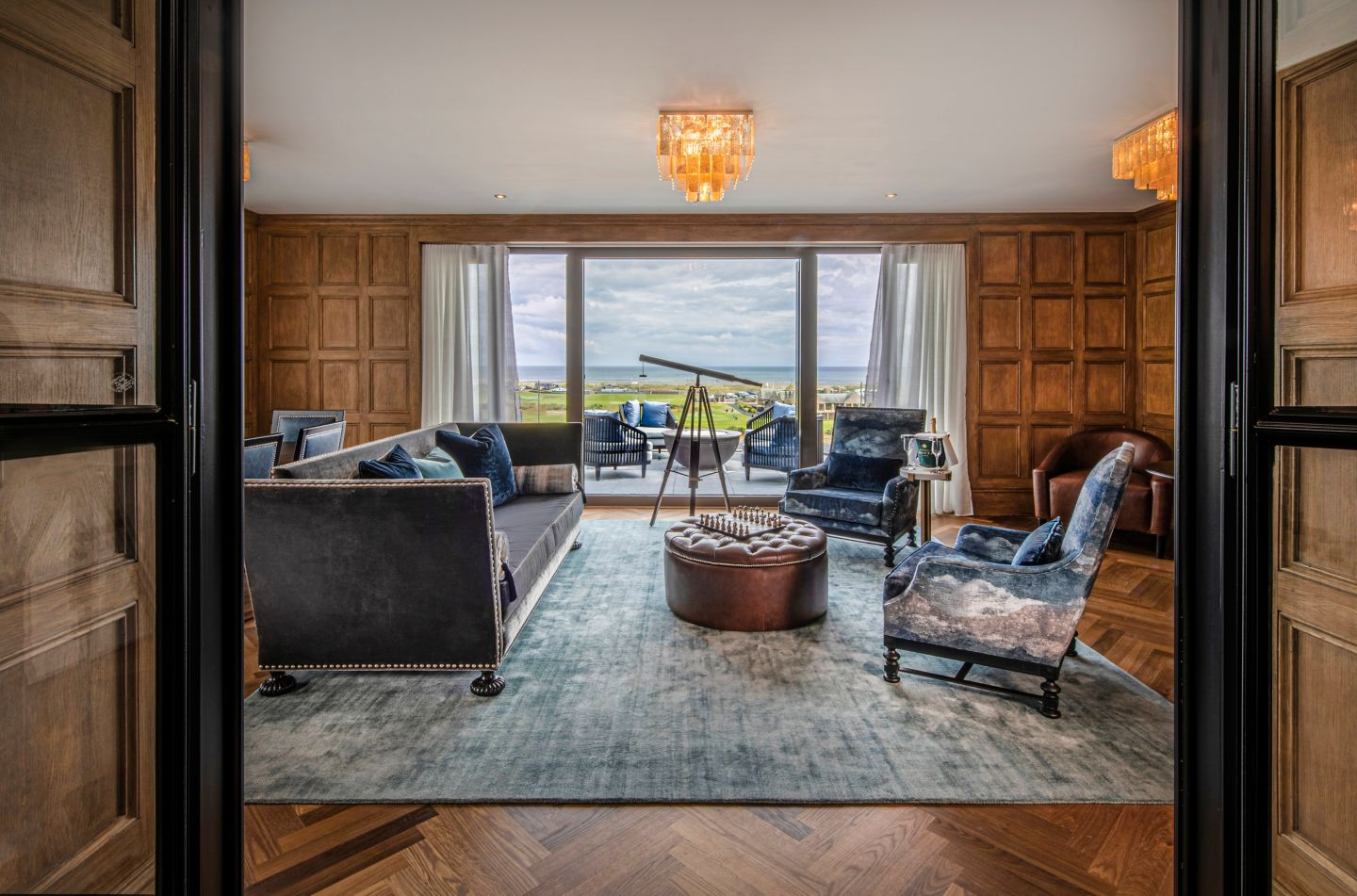 The Penthouse suite living area at the Old Course Hotel, St Andrews, with views out to the North Sea