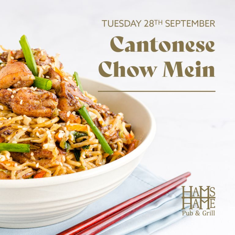 A dish of Cantonese Chow Mein with red chopsticks