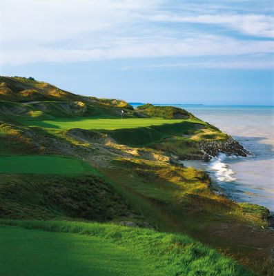 A view of the green of the Straits Course seventh hole with Lake Michigan on the right side.