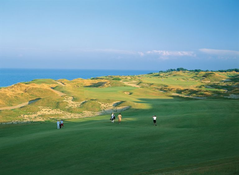 A view of the green from the fairway of hole 14 on the Straits Course at Whistling Straits.