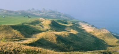 Golfers walking on the fairway of hole 13 of the Straits Course at Whistling Straits.