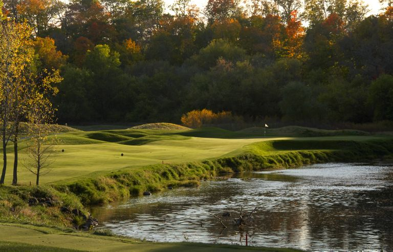 The green of hole 11 on The River Course in the distance with the river on the right.