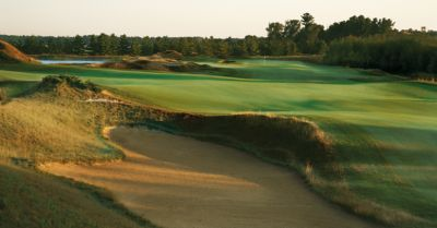 View of the green of hole 16 on the Irish Course from a sand trap.