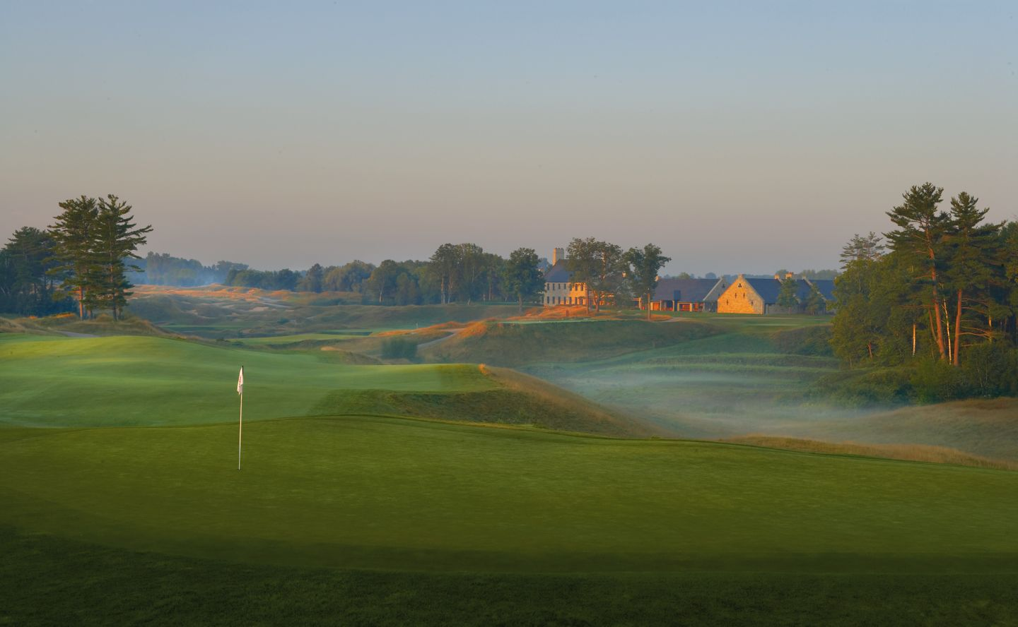 A view from the green of the tenth hole on the Straits course with the Clubhouse in the background.
