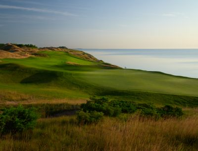 A view of the green down the fairway of the fourth hole on the Straits golf course with Lake Michigan on the right.