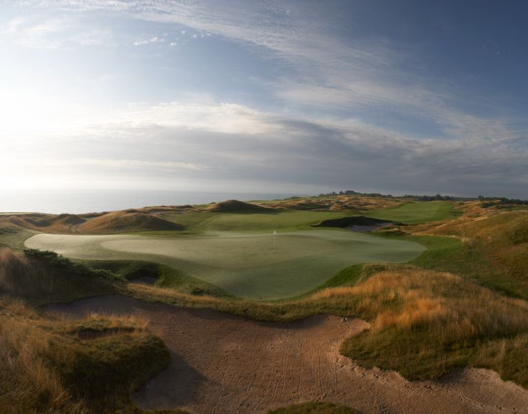 A few of the green with bunkers and water of the eleventh hole of the Straits Course at Whistling Straits.