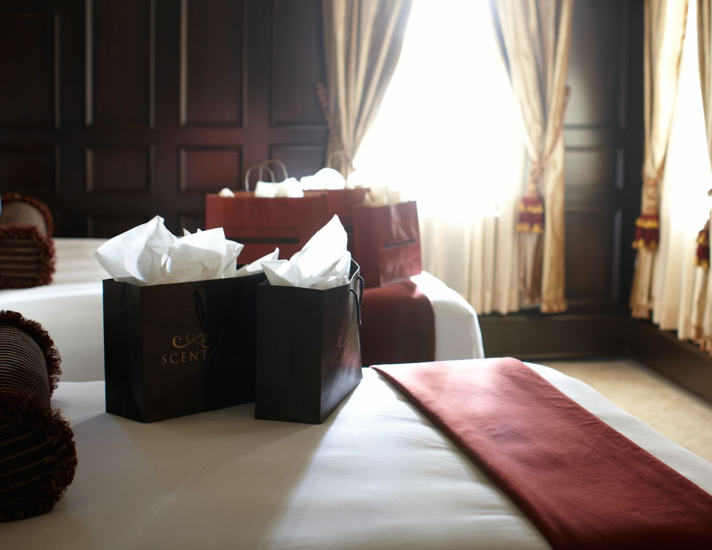 Shopping bags in a hotel room