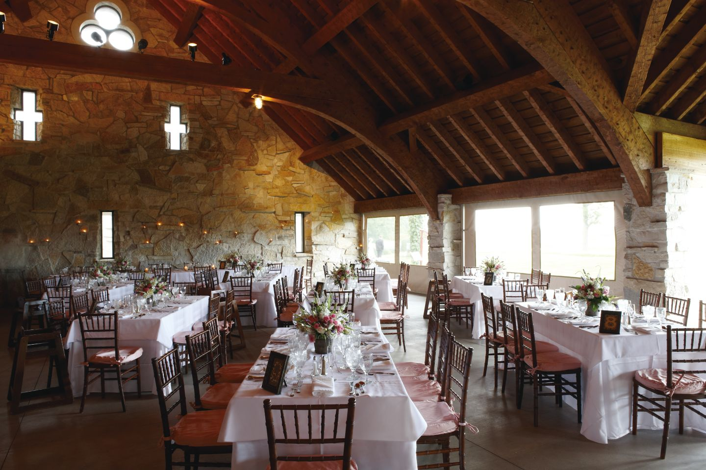 Tables with place settings in the Irish Barn