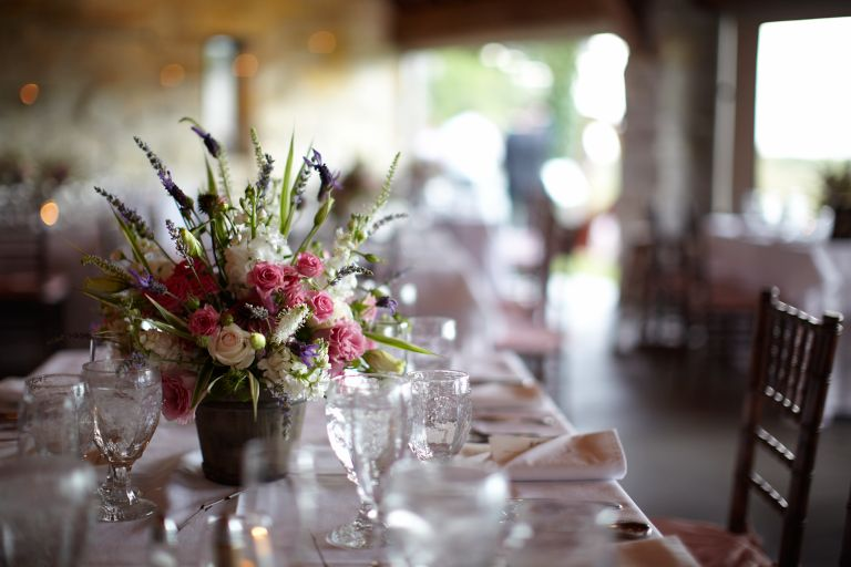 A table setting with a vibrant floral centerpiece.