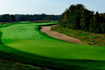 The green of hole 18 on The River Course with the fariway in the background.